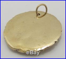 14K solid yellow gold Coin Leo Zodiac pendant